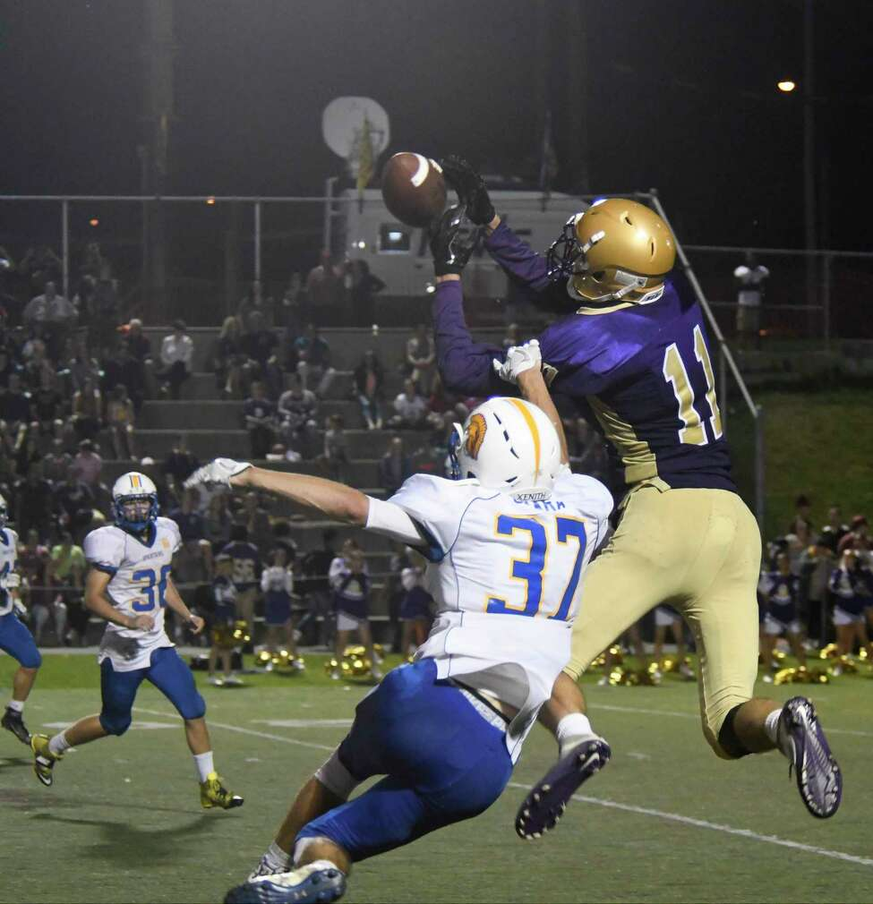 Queensbury's Liam O'Mara attempts to intercept a pass intended for Amsterdam's Louis Fedullo during a game on Amsterdam's Senior Night, Friday in Amsterdam, N.Y. (Jenn March/Special to the Times Union)
