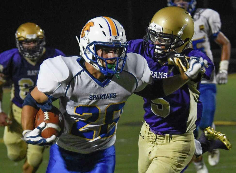 Amsterdam's Jose Merced chases after Queensbury's Patrick Conway during a game on Amsterdam's Senior Night, Friday in Amsterdam, N.Y. (Jenn March/Special to the Times Union)