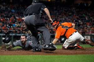SAN FRANCISCO, CA - SEPTEMBER 15: Daniel Descalso #3 of the Arizona Diamondbacks is tagged out at home plate by Nick Hundley #5 of the San Francisco Giants in front of umpire Doug Eddings #88 during the second inning at AT&T Park on September 15, 2017 in San Francisco, California.  (Photo by Jason O. Watson/Getty Images)