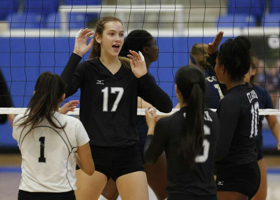 Clark's Kara McGhee (17) celebrates with her teammates after a point against O'Connor in volleyball on Friday, Sept. 15, 2017. The Panthers rallied from losing the first two games and defeated the Cougars in the deciding game to win, 3-2. (Kin Man Hui/San Antonio Express-News) Photo: Kin Man Hui, Staff / San Antonio Express-News / ©2017 San Antonio Express-News