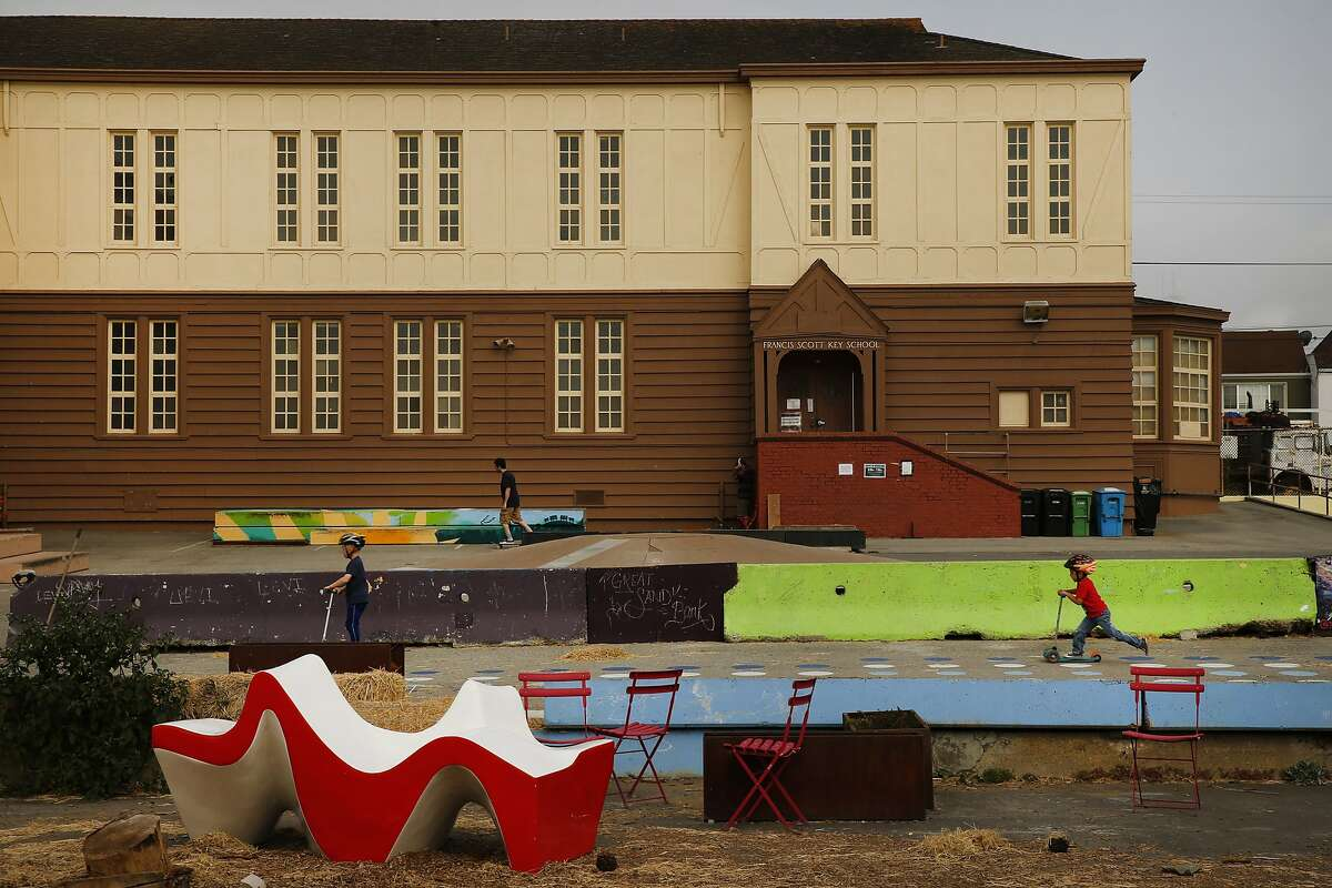 """Rafael Trank, 4, (in red) rides his scooter as he chases Judah Van Harken, 6, at the Francis Scott Key Annex on Wednesday, Sept. 6, 2017, in San Francisco, Calif. City and school district officials are considering tearing down this site located at 1360 43rd Ave to build apartment units for teachers and other educators to help address the """"housing crisis"""" in S.F. Currently, it's an open space used by families and others in the community."""