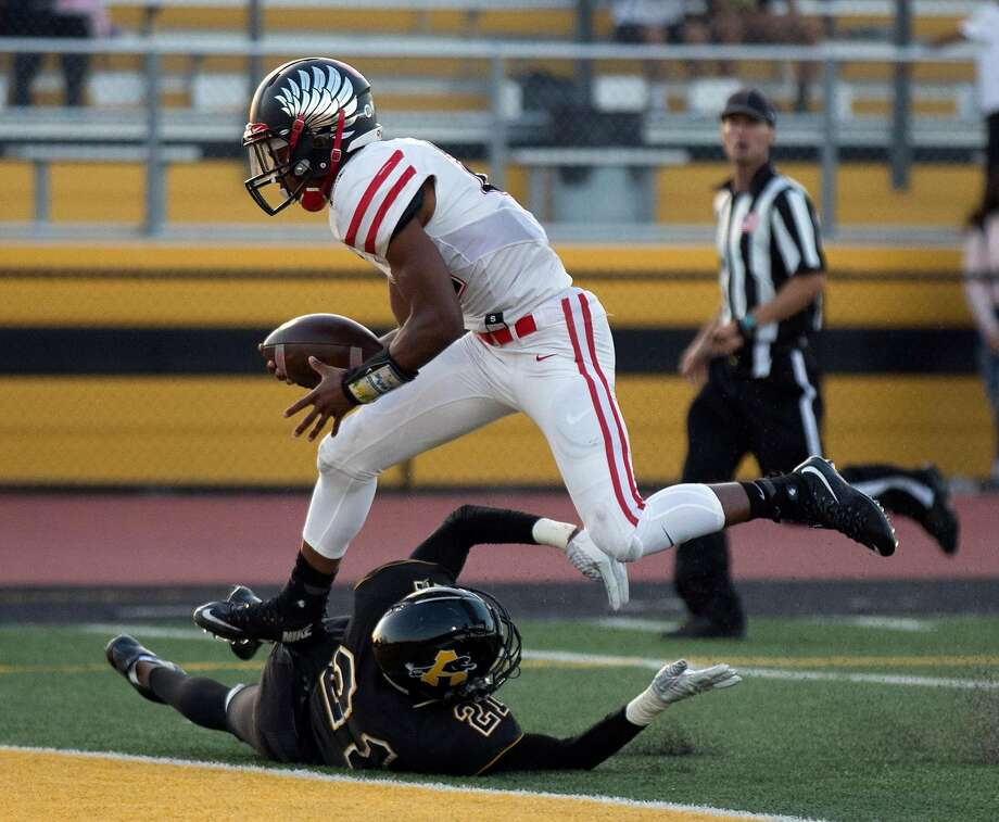 Clayton Valley''s Makhi Gervais (21) vaults over Antioch's Dejuan Butler for a touchdown during the first quarter of a high school football game, on Friday, Sept. 15, 2017 in Antioch, Calif. Photo: D. Ross Cameron, Special To The Chronicle