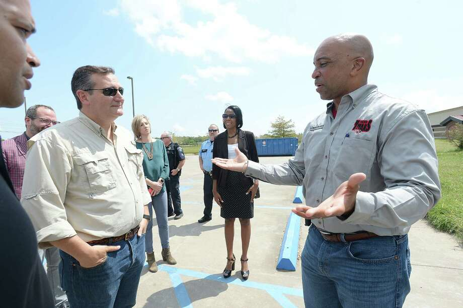 Port Arthur ISD Superintendent Dr. Mark Porterie meets with officials and Sen. Ted Cruz at Adams Elementary School in Port Arthur Friday. The 9th Avenue site sustained flood damage in Tropical Storm Harvey and is in the process of repairs and renovation. School officials expect students to be be back in the building after Thanksgiving and plans are in place to place them within other district schools in the meanwhile. U.S. Sen. Ted Cruz paid a visit to the school and met with city and school officials Friday on a recent tour of his flood-affected district. Photo taken Friday, September 15, 2017 Kim Brent/The Enterprise Photo: Kim Brent / BEN