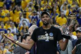Golden State Warriors' Kevin Durant holds the The Bill Russell MVP Award after Game 5 of the 2017 NBA Finals at Oracle Arena on Monday, June 12, 2017 in Oakland, Calif. The Golden State Warriors defeated the Cleveland Cavaliers 129-120 to win The Finals.