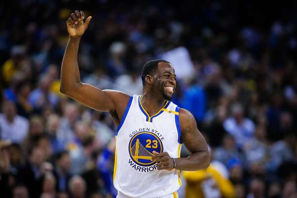 Golden State Warriors player Draymond Green (23) cheers after the referees call a foul in his favor in the second half of an NBA basketball game against the Utah Jazz at Oracle Arena in Oakland, Calif. on Monday, April 10, 2017. The Jazz defeated the Warriors 105-99.