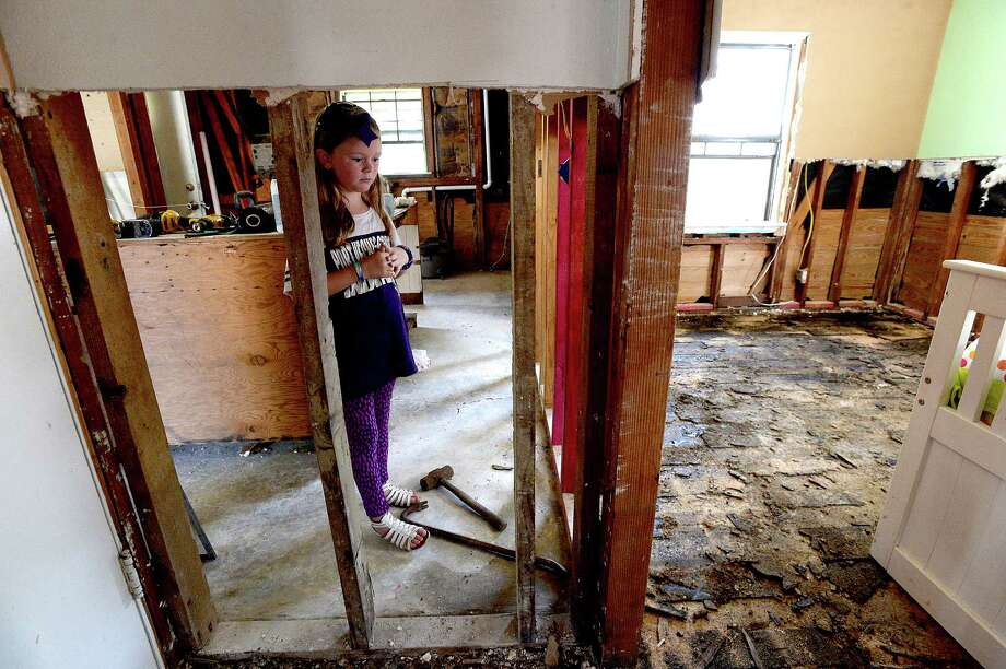 Anslee Barbosa, 8, looks at what was her bedroom as families throughout the flood-damaged neighborhoods of Groves near US 73 continue clean-up and repairs. Photo taken Friday, September 15, 2017 Kim Brent/The Enterprise Photo: Kim Brent / BEN