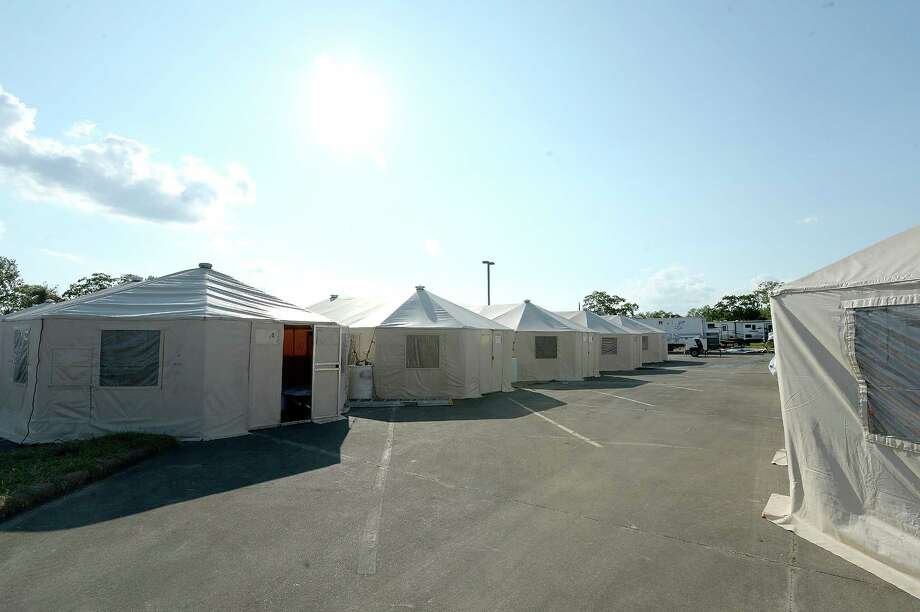 The 12-bed family tents are seen as the Incident Commander with Emergency Management offers & Mall becomes second location for Port Arthur evacuee tents ...