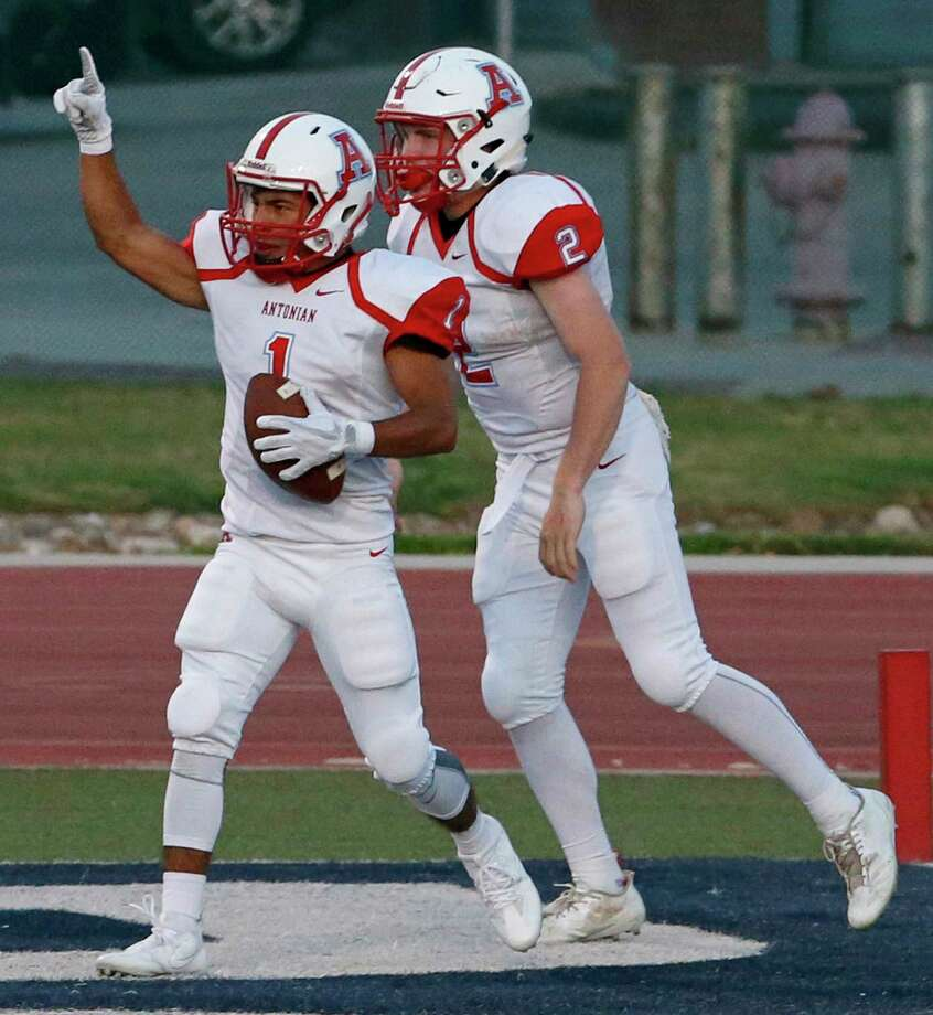 Antonian's Isaiah Maldonado (left) celebrates with teammate Kyte McDonald after scoring a touchdown during first half action against South San Friday Sept. 15, 2017 at South San Stadium. Photo: Edward A. Ornelas, San Antonio Express-News / © 2017 San Antonio Express-News