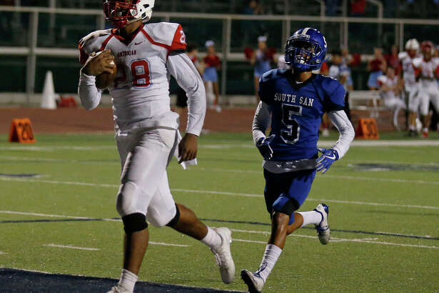 Antonian's Devin Grant scores a touchdown ahead of South San's Josiah Veloz during first half action Friday Sept. 15, 2017 at South San Stadium.