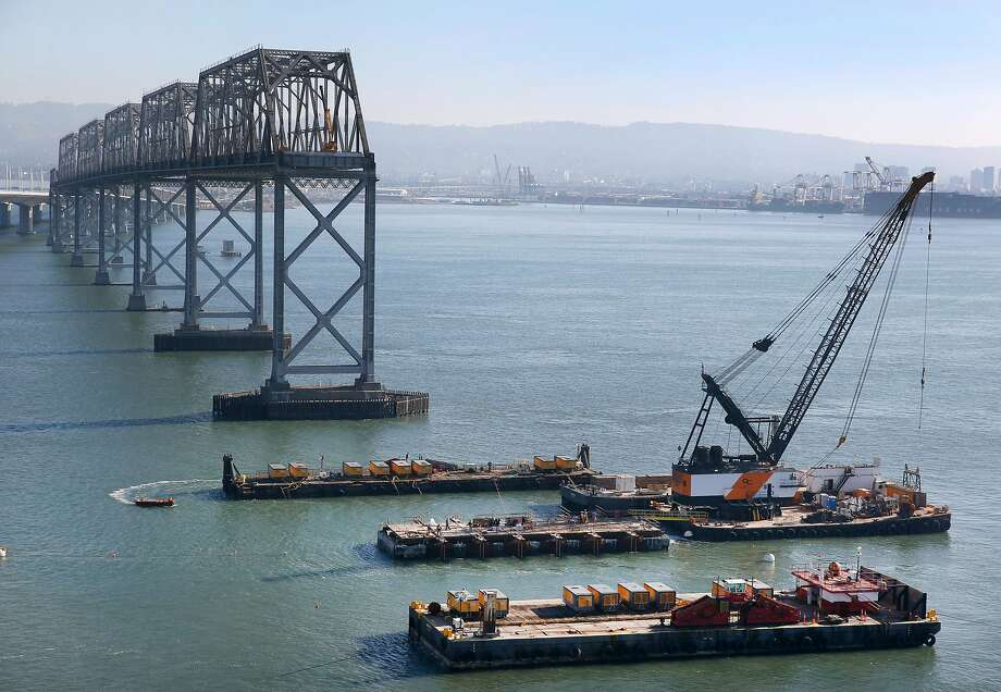 Preparations for an implosion took place on a pier of the old Bay Bridge on Wednesday, Nov. 11, 2015. A demolition team detonated a number of piers on the easter span of the bridge Saturday morning. Photo: Paul Chinn, The Chronicle