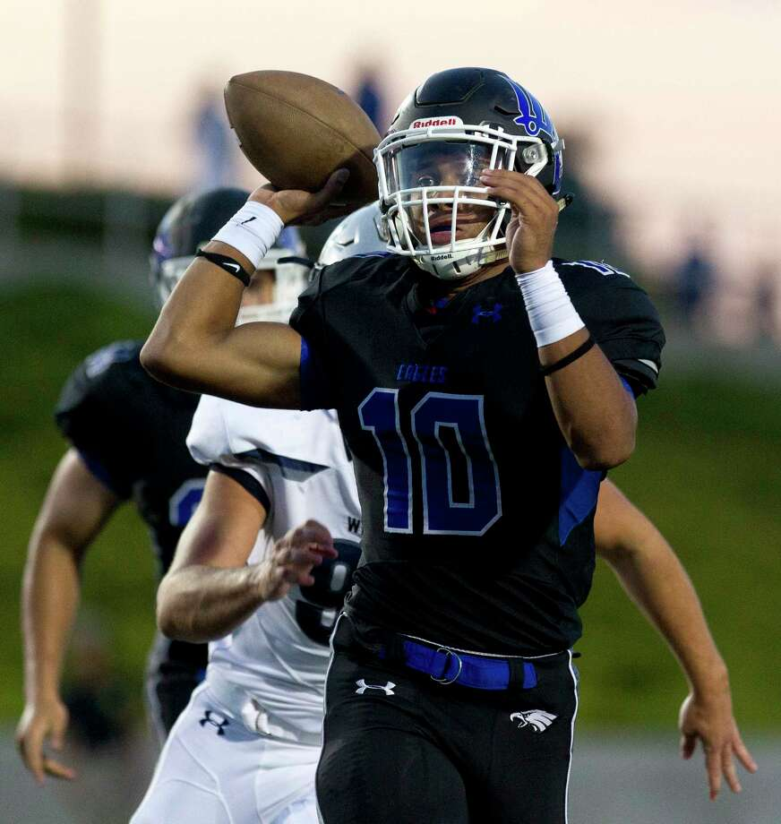 New Caney quarterback Jordan Cooper (10) throws under pressure during the first quarter of a non-district high school football game against Tomball Memorial at Texan Drive Stadium, Friday, Sept. 8, 2017, in New Caney. Photo: Jason Fochtman, Staff Photographer / Internal