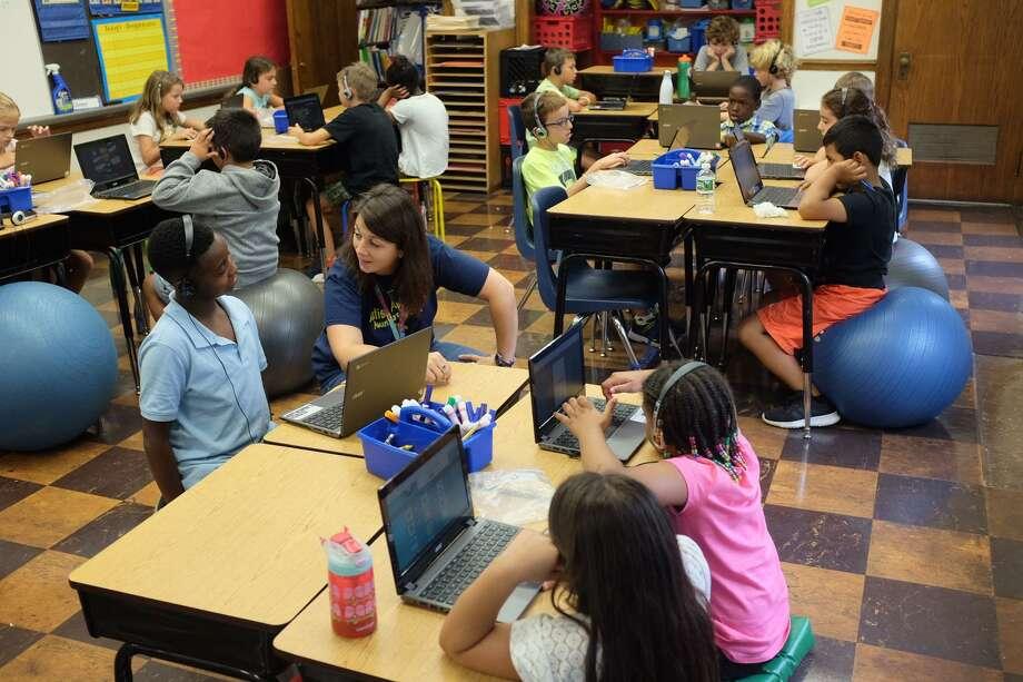 Third-grade students use Chromebooks in Beth Olson's Rowayton Elementary School classroom on the afternoon of Sept. 15, 2017. Photo: R.A. Schuetz / Hearst Connecticut Media