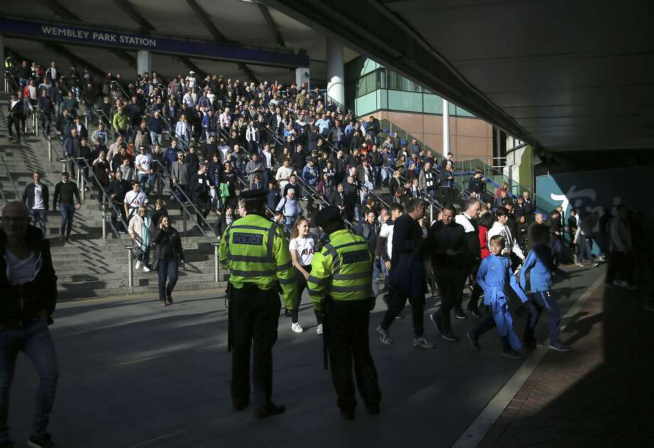 Officers observe the crowd outside Wembley Park Station before a soccer match. Security was increased across Britain after Friday's subway bombing in London that injured 29 people. Photo: Tim Ireland, Associated Press