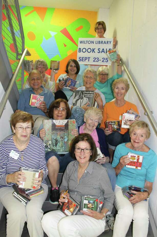 Wilton Library's Awesome Autumn Book Sale fundraiser runs Saturday, Sept. 23 through Monday, Sept. 25. Pictured are just some of the more than 100 volunteers who work on the book sales throughout the year ( 1st row, l-r) Jan Galletly, Pam Miller, Jean Schlesinger; 2nd row: Tina Gardner, Michaela Durkin, SSND; 3rd row: Phil Canella, Jan MacEwen, Maureen Granito, 4th row: Teddi Tucci, Amy Kirk, Linda Fein; top row; Pat Gould. Wilton Library, 137 Old Ridgefield Road, Wilton; www.wiltonlibrary.org; 203-762-3950. Photo: Contributed Photo