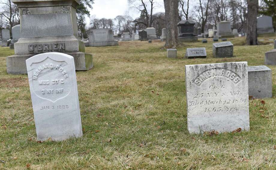 """Grave stone of Civil War Private Bernard Ross, """"Albany's Little Drummer Boy,"""" left, and his father Simon Ross at St. Agnes Cemetery Friday, March. 10, 2017 in Menands, N.Y. Cemetery historian Kelly Grimaldi received a tintype of Bernard Ross from a woman in Connecticut who found the photo. (Lori Van Buren / Times Union) Photo: Lori Van Buren / 20039929A"""