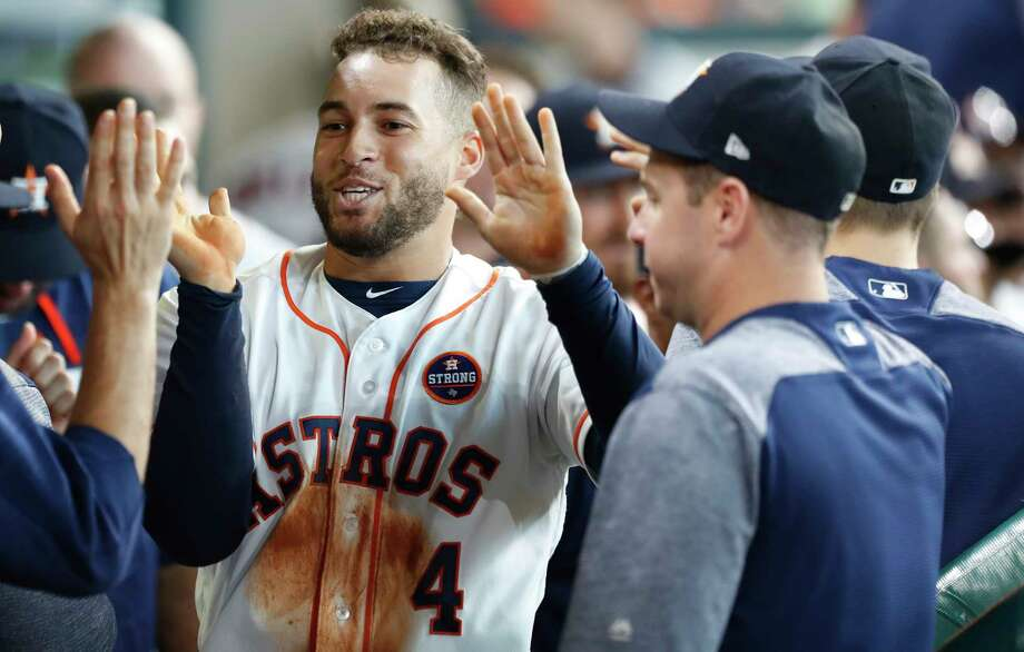 Houston Astros George Springer (4) celebrates in the dugout after scoring a run on Josh Reddick's  RBI double during the second inning of an MLB baseball game at Minute Maid Park, Saturday, Sept. 16, 2017, in Houston. Photo: Karen Warren, Houston Chronicle / @ 2017 Houston Chronicle