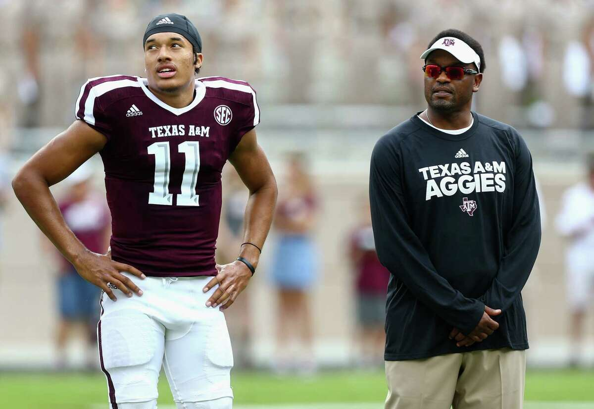 COLLEGE STATION, TX - SEPTEMBER 16: Kellen Mond #11 of the Texas A&M Aggies and head coach Kevin Sumlin of the Texas A&M Aggies at Kyle Field on September 16, 2017 in College Station, Texas.