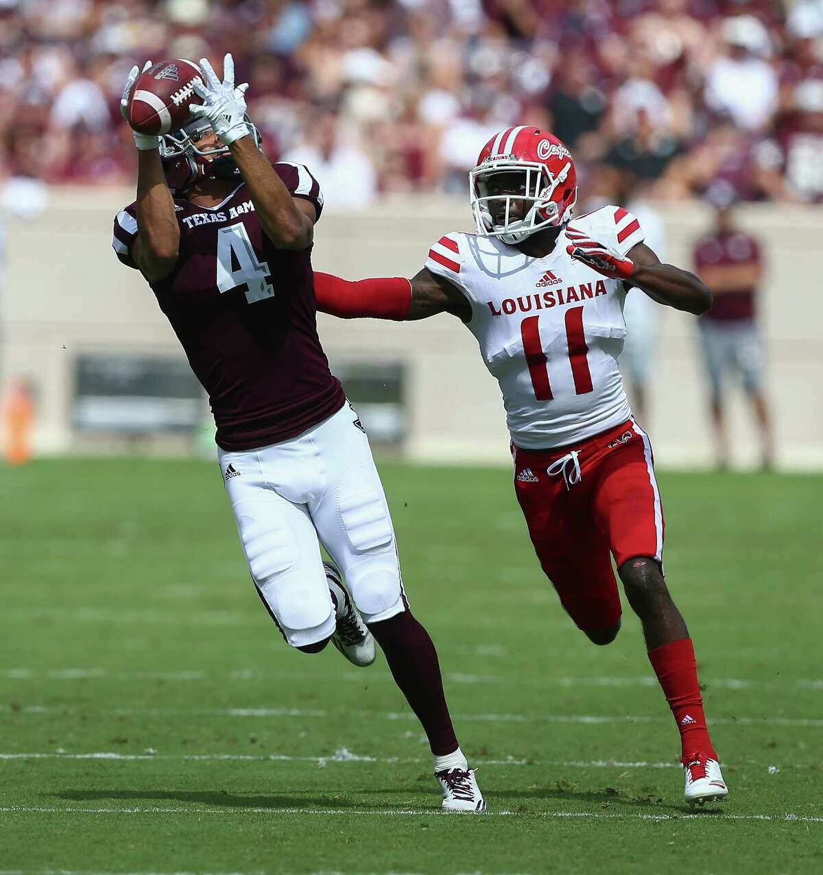 COLLEGE STATION, TX - SEPTEMBER 16: Damion Ratley #4 of the Texas A&M Aggies makes a catch as he gets behind Lorenzo Cryer #11 of the Louisiana-Lafayette Ragin Cajuns at Kyle Field on September 16, 2017 in College Station, Texas.