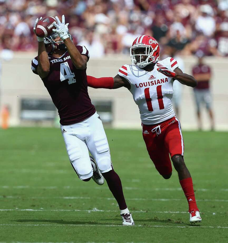COLLEGE STATION, TX - SEPTEMBER 16:  Damion Ratley #4 of the Texas A&M Aggies makes a catch as he gets behind Lorenzo Cryer #11 of the Louisiana-Lafayette Ragin Cajuns at Kyle Field on September 16, 2017 in College Station, Texas. Photo: Bob Levey, Getty Images / 2017 Getty Images