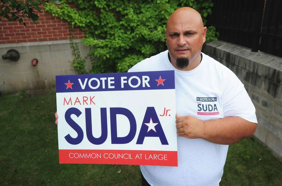 Officer Mark Suda holds one of his campaign signs Friday, Sept. 15. Suda, who is running for a Common Council at-Large seat, said that his notoriety as a police officer has made him a target for campaign sign thefts. Photo: Erik Trautmann / Hearst Connecticut Media / Norwalk Hour