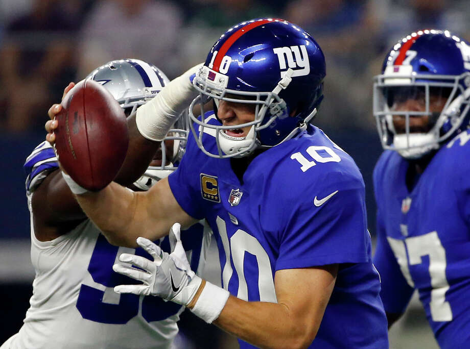 FILE - In this Sept. 10, 2017 file photo, Dallas Cowboys defensive end DeMarcus Lawrence (90) sacks New York Giants quarterback Eli Manning (10) in the first half of an NFL football game in Arlington, Texas. Manning felt the Cowboys' pass-rush wrath three times, but the issue for the Giants was that it's O-line was more of a 0-line, as in zero production.(AP Photo/Ron Jenkins) Photo: Ron Jenkins, FRE / FR171331 AP