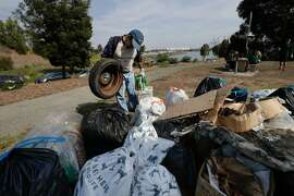 Eric Hoover found a tire and places it into the pile collected  at India Basin Shoreline Park on Saturday, Sept. 16, 2017 in San Francisco, CA.