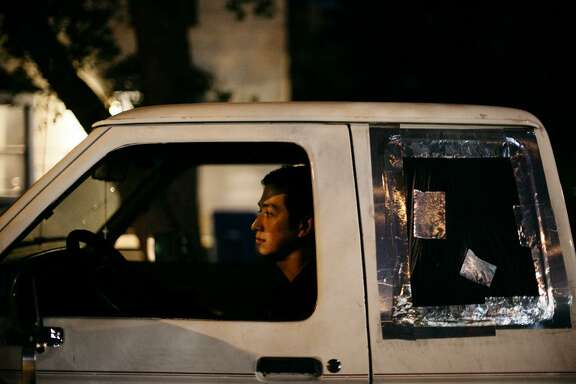 Marc Rodriguez, now 23, sits in the pickup truck where he was shot on Aug. 29, 2016. Marc was talking to his girlfriend Raven on the phone after a three-hour night class at San Antonio College when a woman, later identified by police as Alexis Garcia, approached his window and began screaming. Several minutes later, as Rodriguez tried to talk to the woman, police say Ralph Torres shot at him through the back window.
