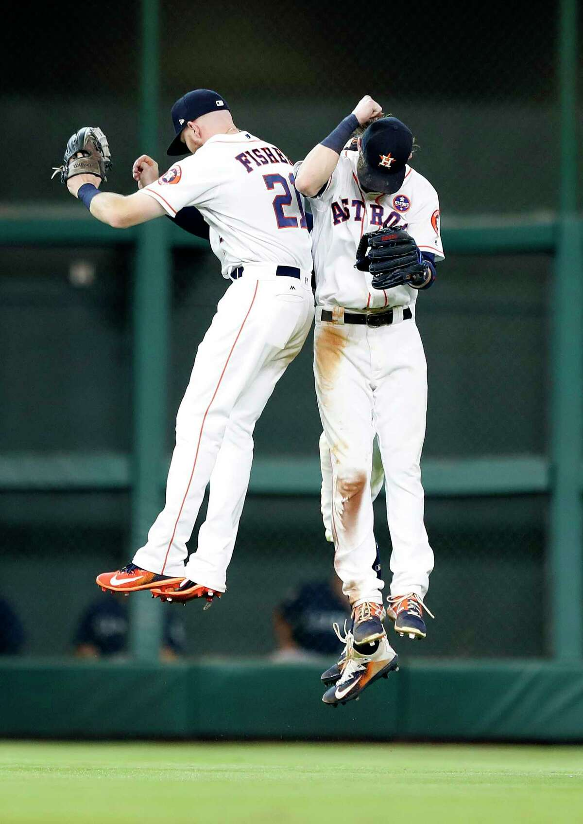 Houston Astros Derek Fisher (21), Josh Reddick (22), and George Springer (4) celebrate after the Astros win 8-6 against the Seattle Mariners during an MLB baseball game at Minute Maid Park, Saturday, Sept. 16, 2017, in Houston.