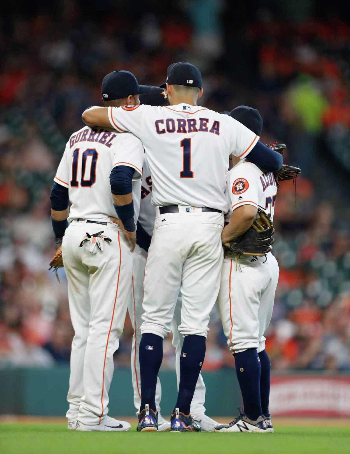 Houston Astros shortstop Carlos Correa (1) conveens the infielders, Yuli Gurriel (10), Alex Bregman (2), and Jose Altuve (27) as relief pitcher Joe Musgrove warmed up on the mound during the eighth inning of an MLB baseball game at Minute Maid Park, Saturday, Sept. 16, 2017, in Houston.