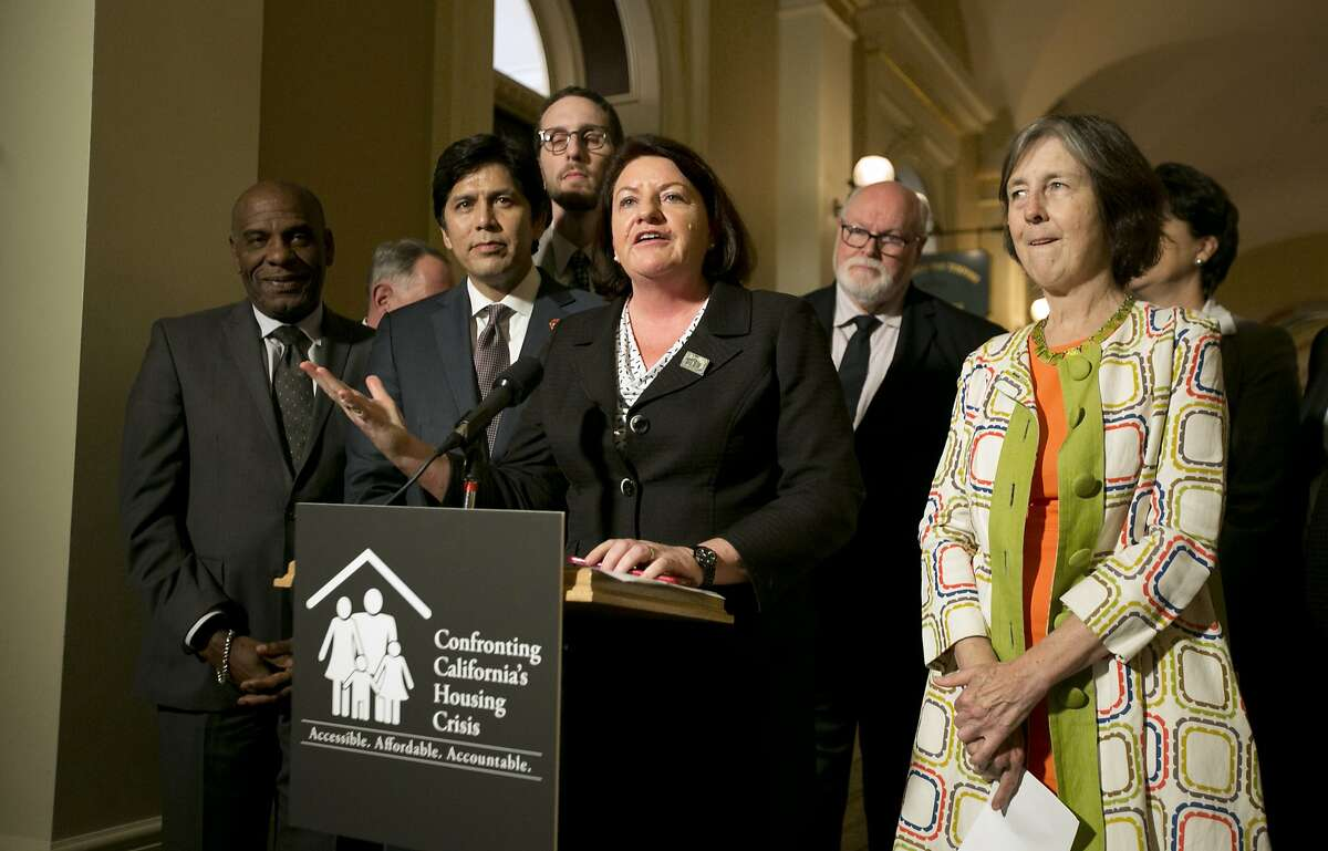 State Sen. Toni Atkins, D-San Diego, flanked by Senate President Pro Tem Kevin de Leon, D-Los Angeles, second from left, and other Democratic lawmakers discusses a package of housing bills approved by the Legislature, during a news conference at the Capitol, Friday, Sept. 15, 2017, in Sacramento.