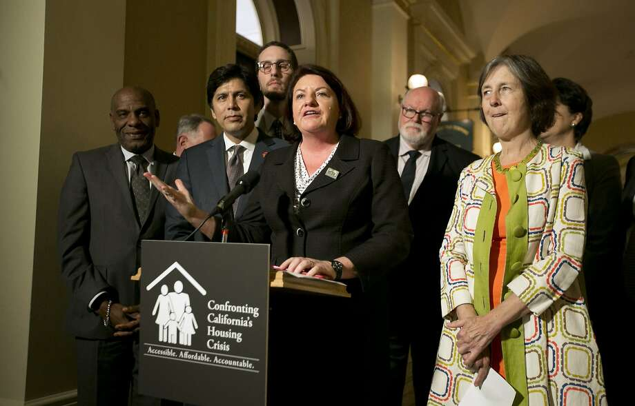 State Sen. Toni Atkins, D-San Diego, is joined by lawmakers Friday to discuss housing bills that the Legislature passed. Photo: Rich Pedroncelli, Associated Press
