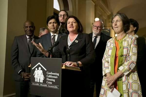 State Sen. Toni Atkins, D-San Diego, flanked by Senate President Pro Tem Kevin de Leon, D-Los Angeles, second from left, and other Democratic lawmakers discusses a package of housing bills approved by the Legislature, during a news conference at the Capitol, Friday, Sept. 15, 2017, in Sacramento, Calif. (AP Photo/Rich Pedroncelli)