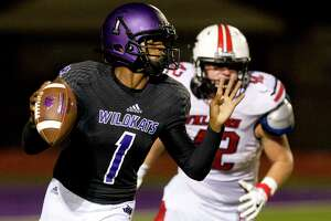 Willis quarterback JerMichael Dickerson (1) avoids the pressure from Huffman defensive linemen Joseph Rankin (42) during the fourth quarter of a non-district high school football game at Berton A. Yates Stadium, Friday, Sept. 15, 2017, in Willis.