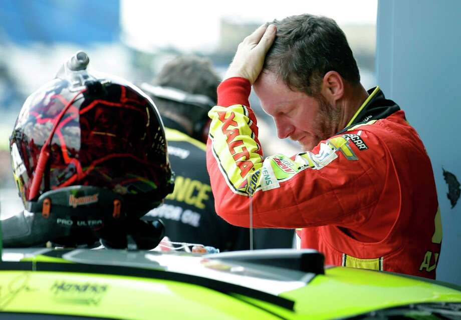 Dale Earnhardt Jr., checks his hair during the final practice for the NASCAR Cup Monster Energy Series auto race at Chicagoland Speedway in Joliet, Ill., Saturday, Sept. 16, 2017. (AP Photo/Nam Y. Huh) Photo: Nam Y. Huh, STF / Copyright 2017 The Associated Press. All rights reserved.