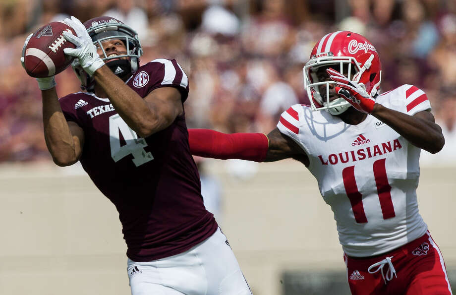 Texas A&M wide receiver Damion Ratley (4) catches a pass over Louisiana-Lafayette defensive back Lorenzo Cryer (11) during the first quarter of an NCAA college football game Saturday, Sept. 16, 2017, in College Station, Texas. (AP Photo/Sam Craft) Photo: Sam Craft, FRE / AP