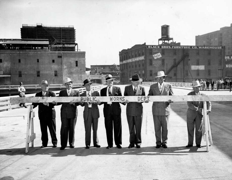 Barricades to the new Milam Street Bridge are removed by Mayor Oscar Holcombe and City Council members on April 21, 1947.  Photo: HC Staff / © Houston Chronicle