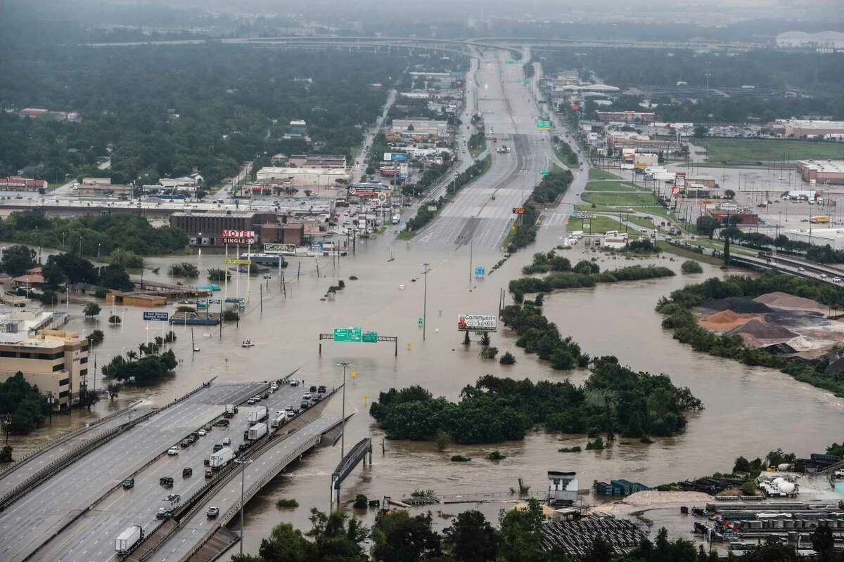 Interstate 10 at Market in Houston is shown blocked by floodwaters from Hurricane Harvey on Aug. 29. ( Brett Coomer / Houston Chronicle )
