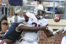 Connecticut defensive back Jamar Summers (21) breaks up a pass intended for Virginia wide receiver Doni Dowling (5) during an NCAA college football game, Saturday, Sept. 16, 2017, at Scott Stadium in Charlottesville, Va. (Andrew Shurtleff/The Daily Progress via AP)