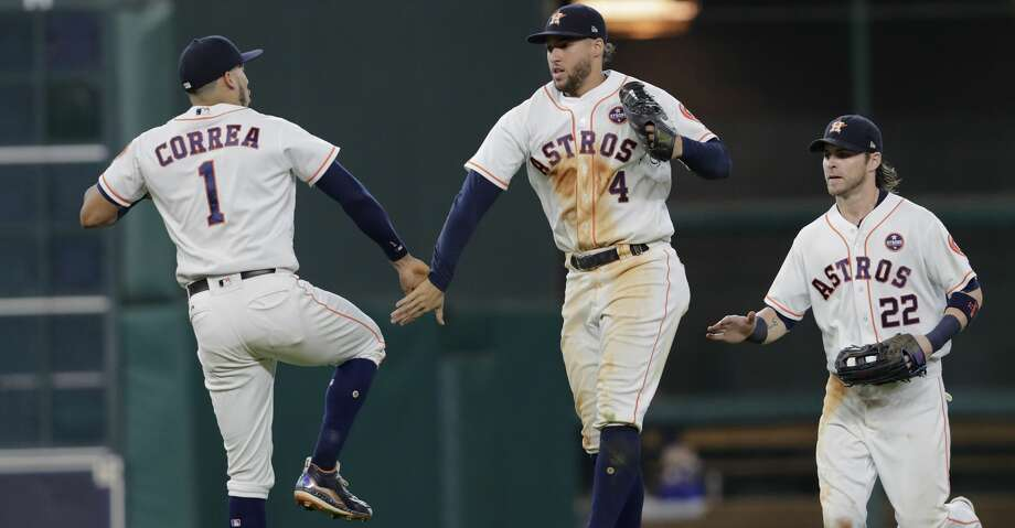 HOUSTON, TX - SEPTEMBER 16:  George Springer #4 of the Houston Astros celebrates with Carlos Correa #1 and Josh Reddick #22 after the game against the Seattle Mariners at Minute Maid Park on September 16, 2017 in Houston, Texas.  (Photo by Tim Warner/Getty Images) Photo: Tim Warner/Getty Images
