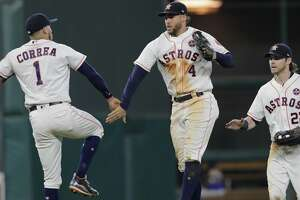 HOUSTON, TX - SEPTEMBER 16:  George Springer #4 of the Houston Astros celebrates with Carlos Correa #1 and Josh Reddick #22 after the game against the Seattle Mariners at Minute Maid Park on September 16, 2017 in Houston, Texas.  (Photo by Tim Warner/Getty Images)