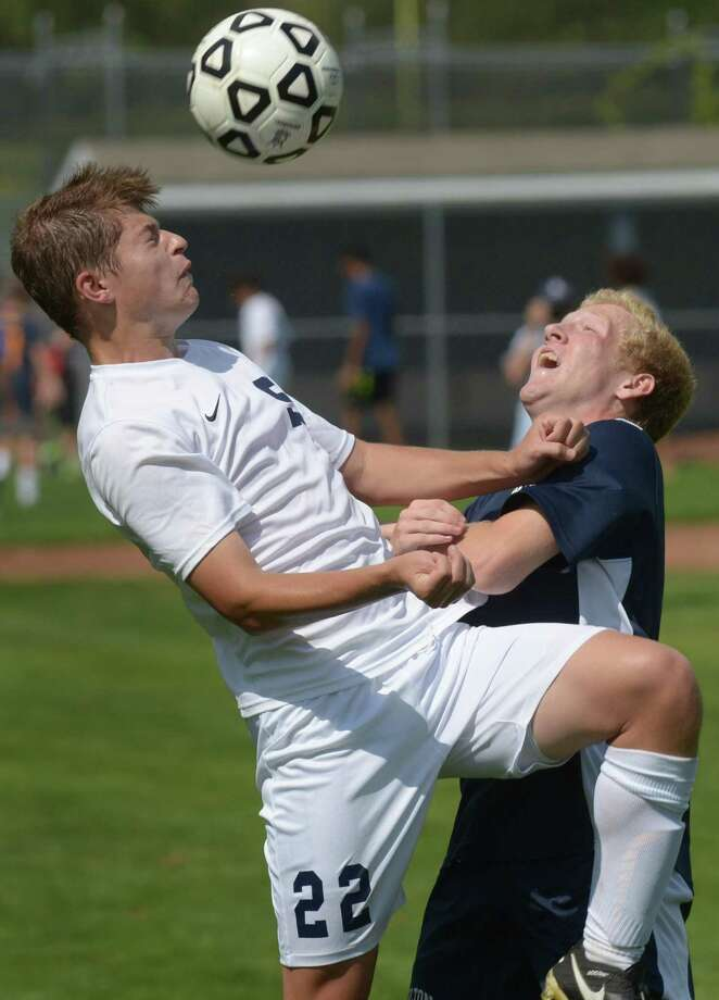 The Staples Wreckers Boys Soccer player #22 Chase Connolly takes on George Murphy of the Wilton High School Warriors during their FCIAC game Saturday, September, 16, 2017 at Staples High School in Westport, Conn Photo: Erik Trautmann / Hearst Connecticut Media / Connecticut Post
