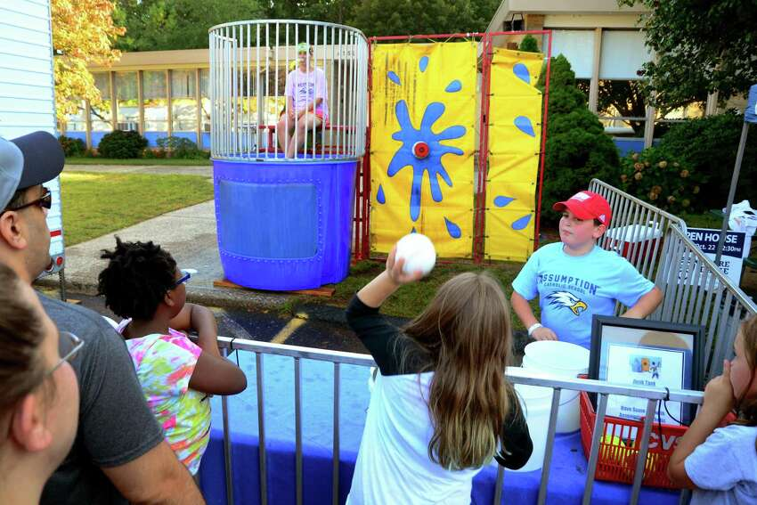 Melanie Cotas, 10, of Bridgeport, tries to dunk teacher Kathy Andrade at the dunk tank station during Our Lady of Assumption Church's 24th Annual SeptemberFest fair on the church grounds in Fairfield, Conn., on Saturday June 17, 2017. The annual family fair continues on Sunday, 1 PM to 6 PM. For more information about the fair go to: http://www.olaffld.org/SeptemberFest