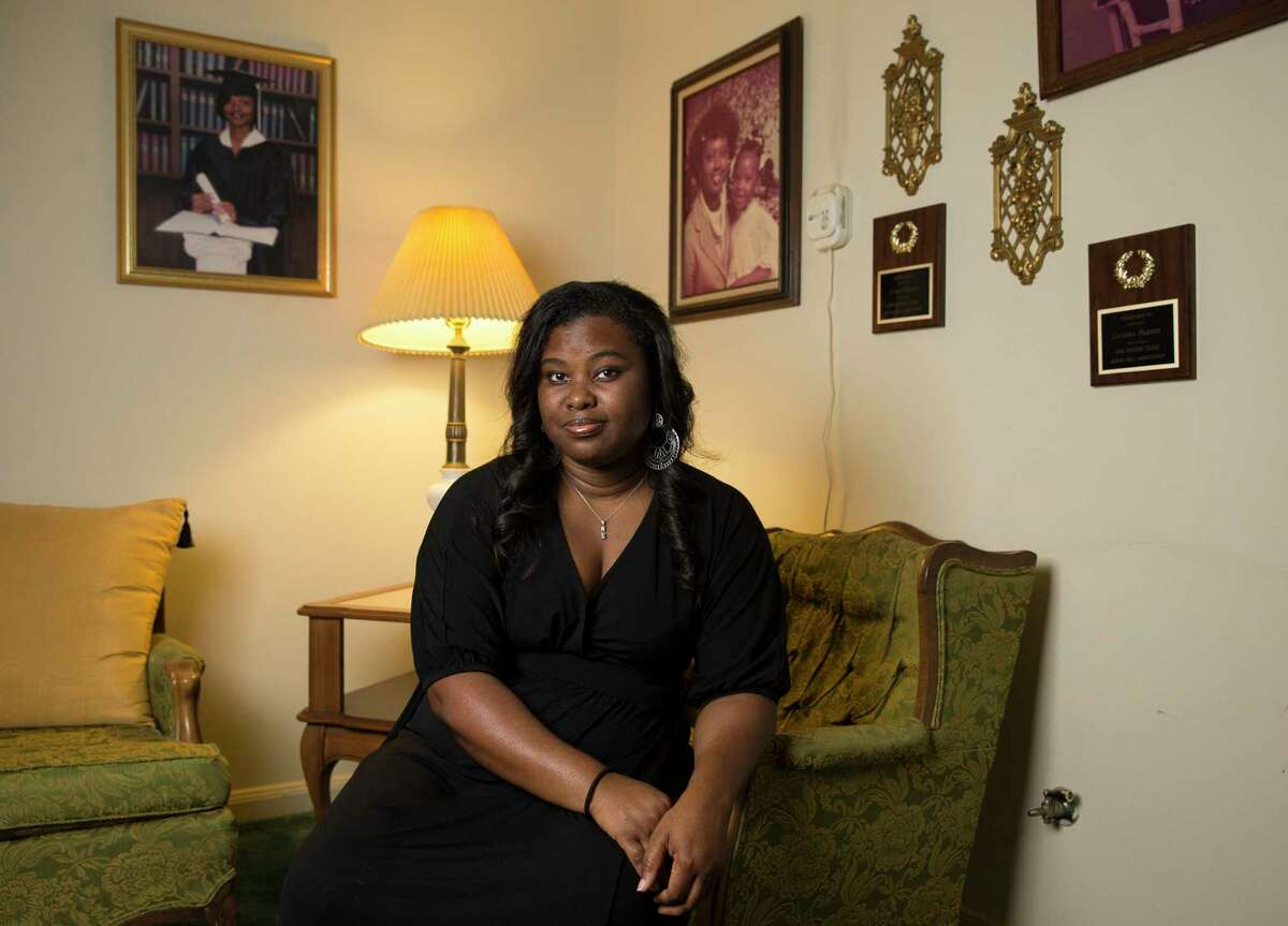 Katina Hightower, 40, poses for a photograph at her grandmother's house Saturday, Sept. 9, 2017, in Houston. Hightower has been working for Burnett staffing, doing work whenever she can pick it up, ever since she was laid off from her job as an executive secretary at Statoil last year. ( Yi-Chin Lee / Houston Chronicle )