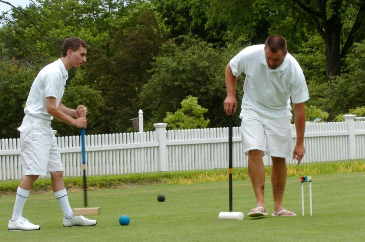 Francis Palasieski, left, and Justin Berbig, both of New Paltz, N.Y., practice before the upcoming croquet tournament on June 22, 2010.