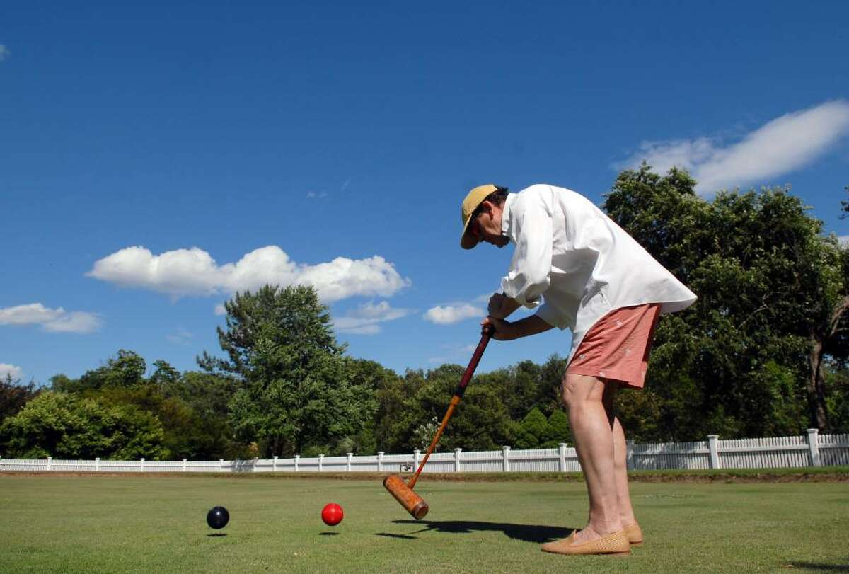 Preston Stuart of Greenwich practices his croquet game on the Greenwich Bowling Green in Bruce Park on a recent afternoon. Stuart, a member of the Greenwich Croquet Club, said he was tuning up for the Greenwich Croquet Club's Invitational Tournament which takes place June 23rd through 27th at a few different sites in town including the bowling green in Bruce Park.