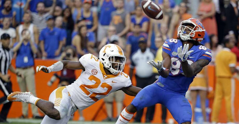 Florida wide receiver Tyrie Cleveland, right, catches the game winning 63-yard touchdown pass in front of Tennessee defensive back Micah Abernathy (22) as time expired in the fourth quarter of an NCAA college football game, Saturday, Sept. 16, 2017, in Gainesville, Fla. Florida won 26-20. (AP Photo/John Raoux) Photo: John Raoux/Associated Press