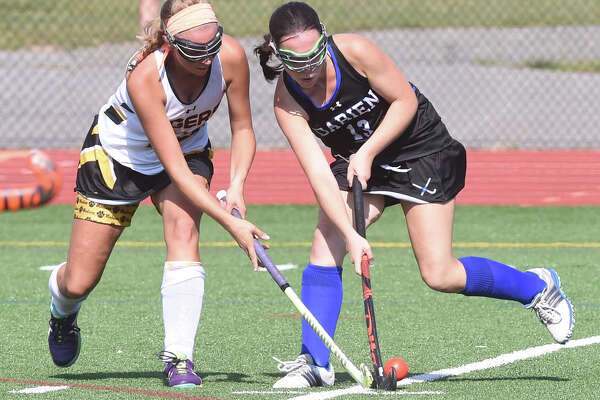 Action from Daniel Hand against Darien field hockey in Madison on  September 16, 2017.  Arnold Gold / Hearst Connecticut Media