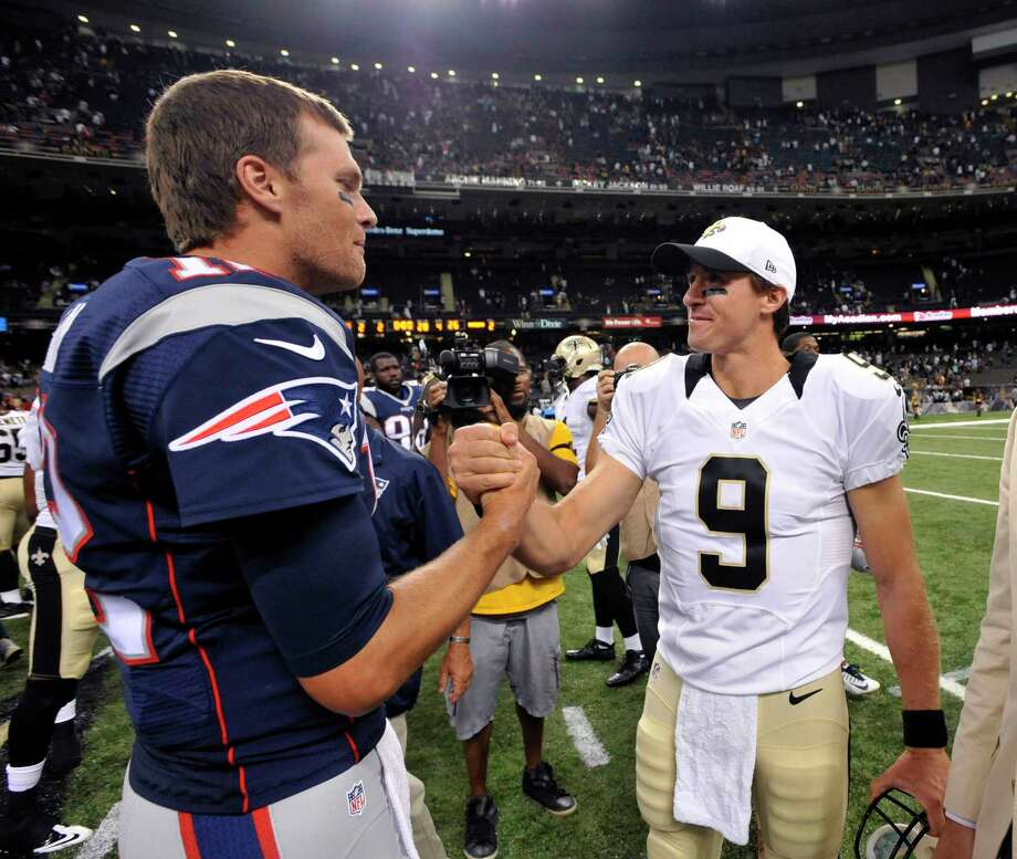 FILE - In this Aug. 22, 2015, file photo, New England Patriots quarterback Tom Brady, left, greets New Orleans Saints quarterback Drew Brees (9) after an NFL preseason football game in New Orleans. The Patriots and the Saints meet Sunday, Sept. 17, in New Orleans. (AP Photo/Bill Feig, File) ORG XMIT: NY361 Photo: Bill Feig / FR44286 AP