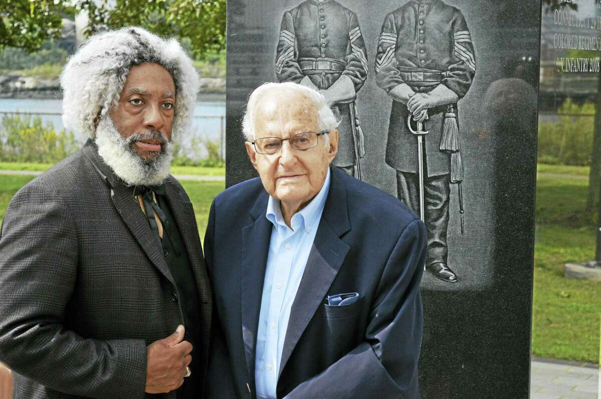 Nathan Richardson, who portrayed Frederick Douglass, stands with Al Mader, president of the Amistad Committee, at Criscuolo Park where a monument to the Connecticut 29th Colored Regiment stands.