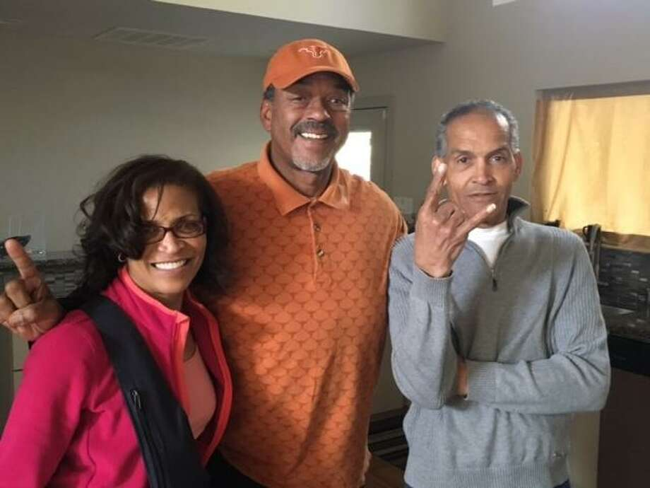 Mildred Whittier (left) and Julius Whittier (right) pose with former Texas teammate Leon O'Neal in 2016. Julius now lives in a memory care facility. Photo: Mildred Whittier / Courtesy Photo